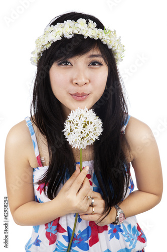 Beautiful woman blowing flower isolated
