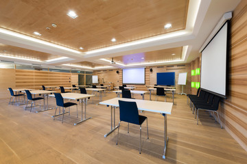 modern wooden conference room with tables an chairs