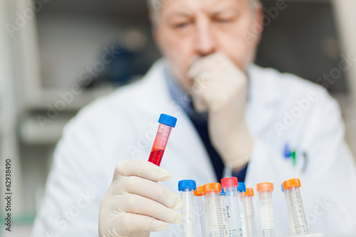 Researcher examining a test tube