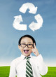 Boy with recycle symbol
