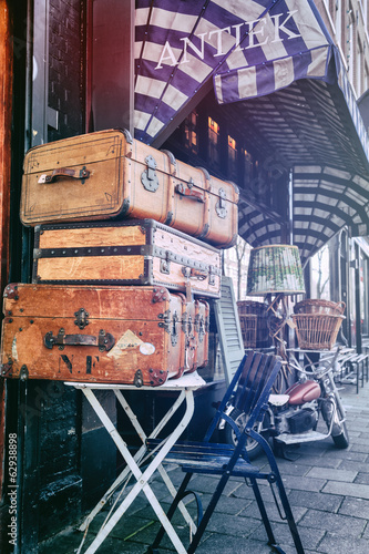 Antiques shop with vintage travel suitcases