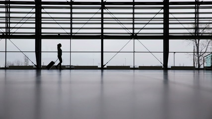 Woman in airport terminal