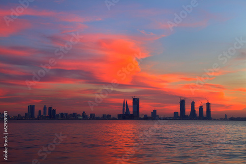 orange red sky during sunset and Bahrain skyline, HDR photograph