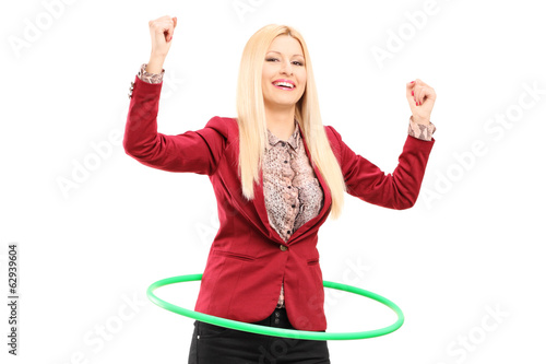 Young woman dancing with a hula hoop