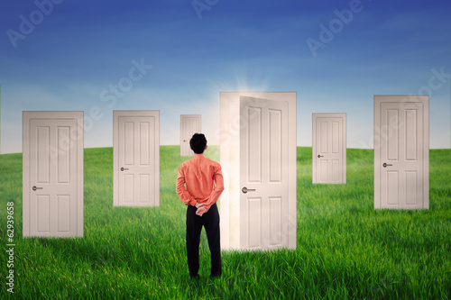 Businessman with opportunity doors