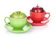 Ripe green and red apple in tea cup