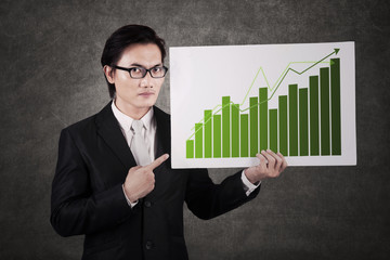 Businessman with chart of profits