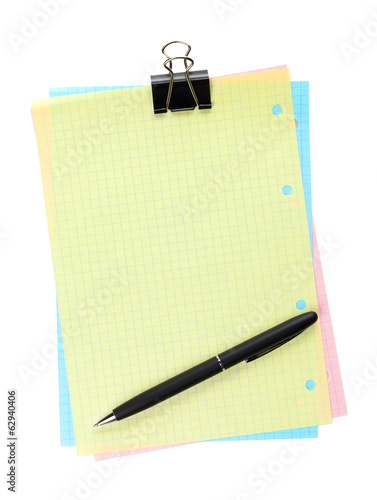 Colorful lined office paper with clip and pen