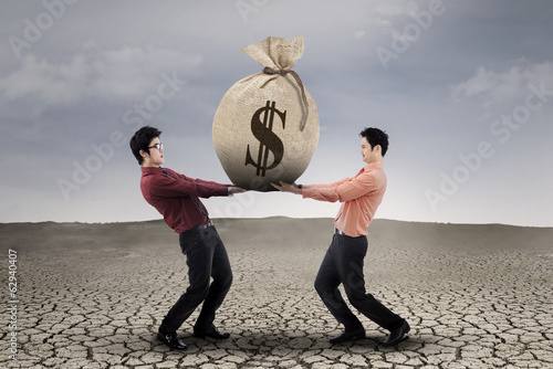 Businessmen carrying a sackful money