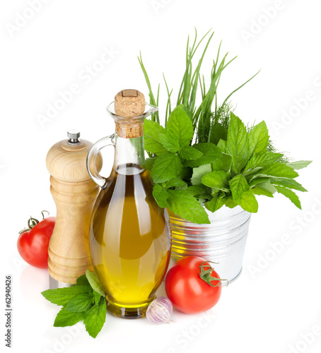 Fresh herbs, tomato, olive oil and pepper shaker