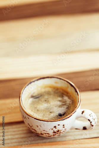 espresso coffee in vintage cup on wood rustic  style table