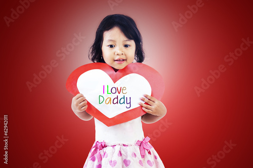 Girl give love card to dad