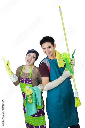 Happy couple ready to cleaning home