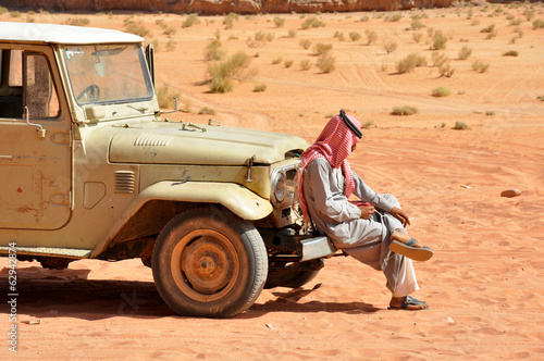 Bedouin setting in his jeep, desert safari in Wadi Rum, Jordan