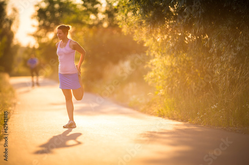 Young woman running outdoors on a lovely sunny summer evening
