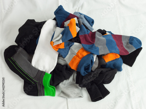 Pile of unsorted socks on white