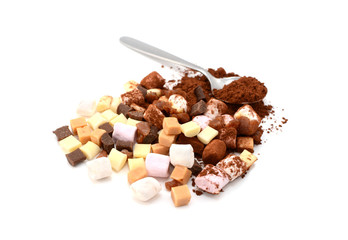 Marshmallows, fudge and caramel pieces with cocoa powder