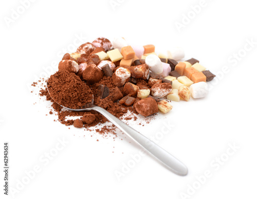 Spoonful of cocoa with toppings for hot chocolate