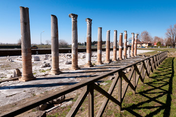 Columns and fence on Archeological area of Aquileia