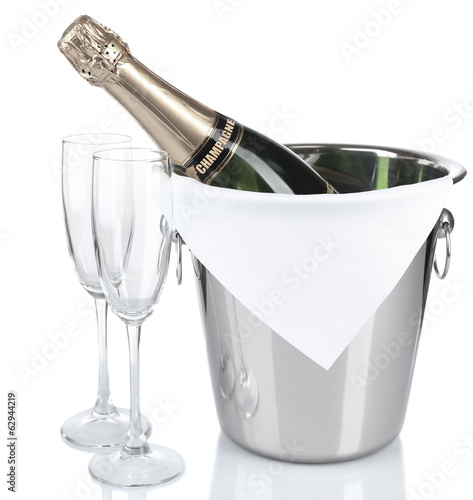 Bottle of champagne in pail and empty glasses, isolated on