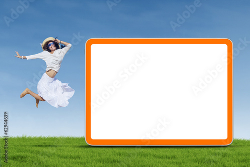 Woman jumping next to empty board