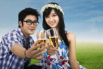 Young couple enjoying champagne outdoor