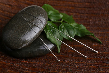 Composition with needles for acupuncture, close up.