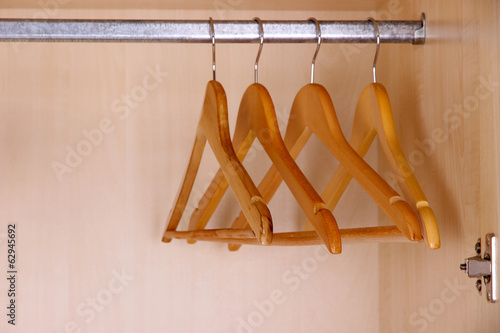 Wooden hangers in wardrobe