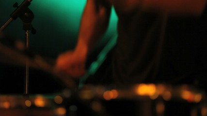 musician in concert, hands playing the drums