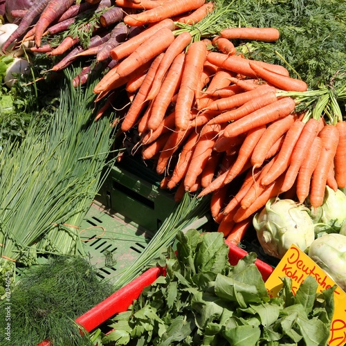Produce market in Germany - carrots and chives