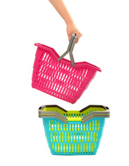 Woman hand taking a shopping basket from a pile.