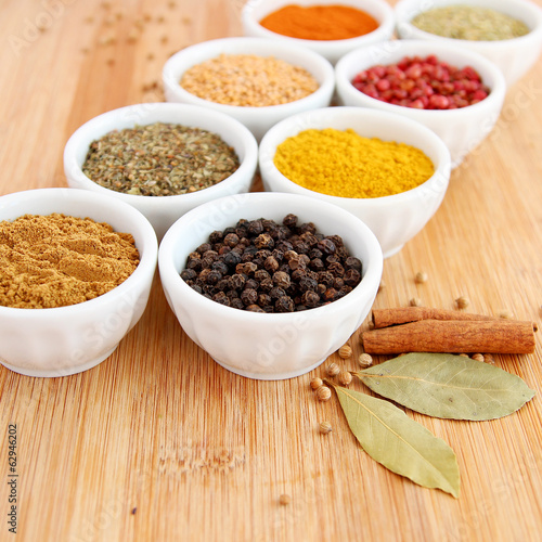 Assorted spices with pepper in the foreground