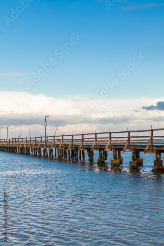Bridge or pier across an expanse of sea
