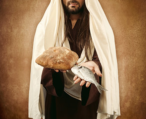 Jesus gives bread and fish