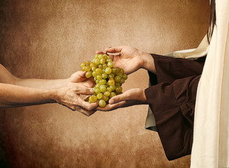 Jesus gives grapes to a beggar