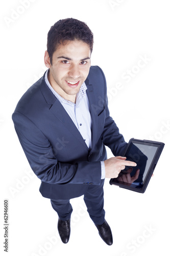 Handsome businessman using a tablet pc, isolated on white