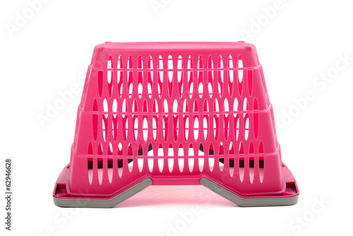 Pink plastic shopping basket.Closeup on empty market basket.