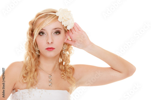 Wedding. Bride girl with hand behind ear listening