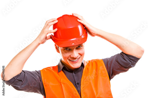 canvas print picture Man worker in safety vest and hard hat. Safety in work.