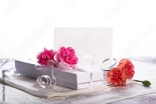 White gift box with flowers