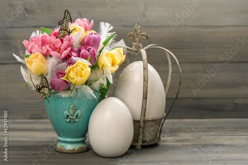 tulip flowers with vintage easter eggs decoration