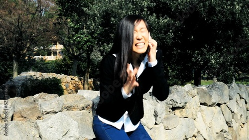 Medium shot of incredibly happy business woman on the phone