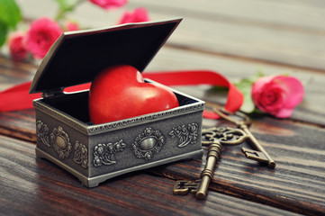 Stone heart in vintage gift box