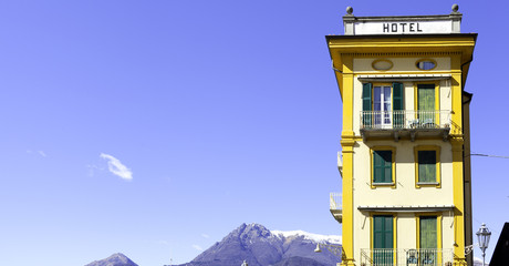 Old hotel and blue sky in Varenna, Lecco Lake, color image