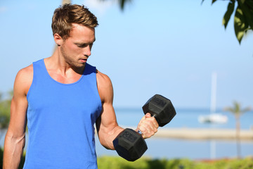 Bicep curl - weight training fitness man outside
