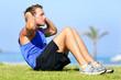 Sit-ups - fitness man training sit up outside