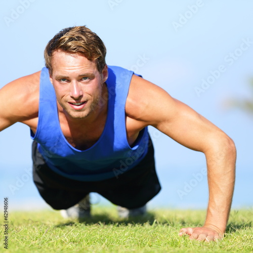 Push ups - fitness man exercising push up outside
