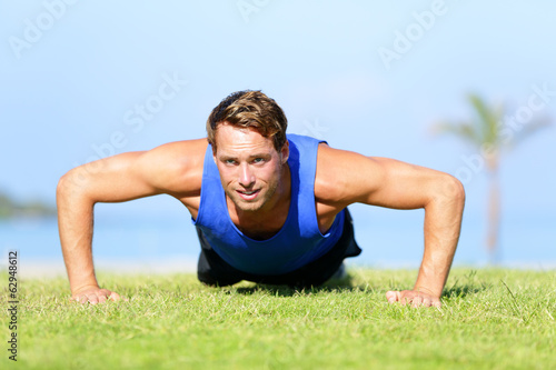Push-ups - fitness man training push up outside