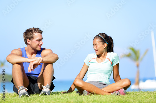 Sport fitness couple relaxing after training