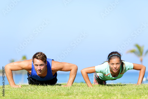 Sport fitness couple doing push ups
